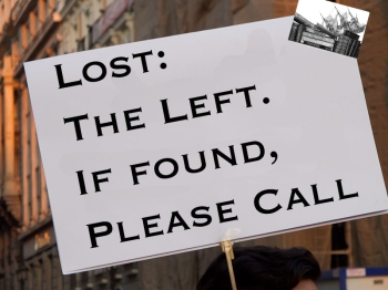 Kadellar took the picture of the person with the sign. The Luddbrarian edited the sign's contents.