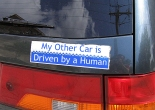 original picture (of the car and bumper sticker) by Beige Albert (at wikipedia). sticker text edited by the Luddbrarian.